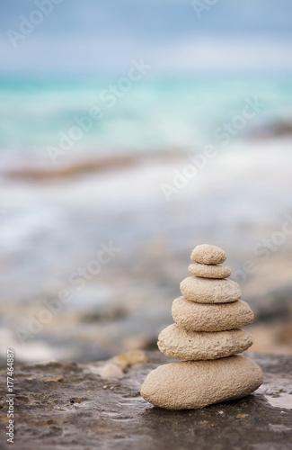 Foto op Aluminium Stenen in het Zand Zen stones, background ocean for the perfect meditation