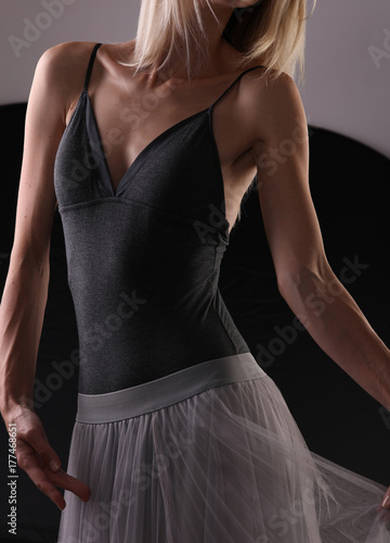 Beautiful young athletic woman , modern ballet dancer , strong female body close Poster