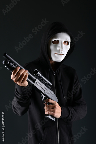 Man in a mask with a gun Poster
