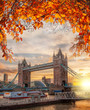 Tower Bridge with autumn leaves in London, England, UK - 177473879