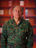 Close up of a serious veteran soldier wearing a military uniform, in a blurred background - 177484488