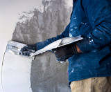 worker plastering tool plaster marble on interior plaster rough.  Selective focus - 177526603
