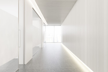 White and glass office corridor