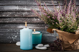 Interior decor with pebbles, blue lit candles - 177540853