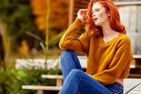 Outdoor atmospheric lifestyle photo of young beautiful lady. Warm autumn. - 177564064