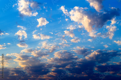 Bright yellow and dark clouds on the  blue sky at sunset or sunrise Poster