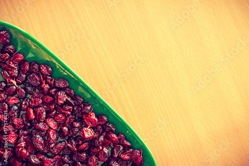 Poster Plate bowl full of red dried cranberries
