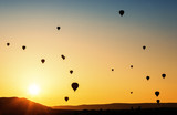 Balloons flying in the sky at sunrise. - 177577277