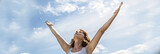zen middle aged woman raising arms up to breathe, panoramic view - 177579025