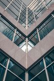 Urban Geometry, looking up to glass building. Modern architecture black and white, glass and steel. X marks the spot. Abstract architectural design. Inspirational, artistic image BW.
