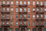 New York City,  old,apartment building with external fire escape - 177589620