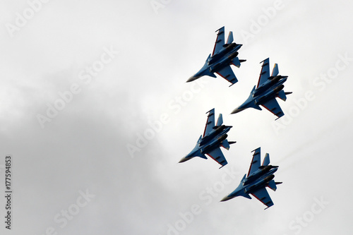 fototapeta na ścianę Fighters in the sky, the flight of the aircraft, a beautiful Airshow