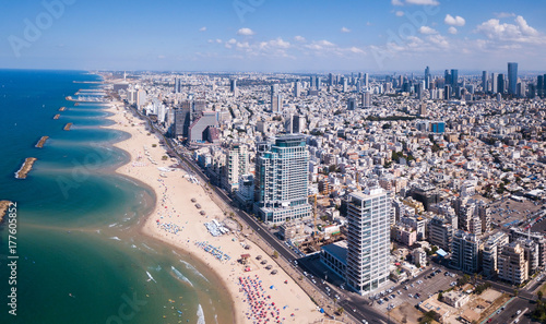 Leinwanddruck Bild Tel Aviv skyline off the shore of the Mediterranean sea - Panoramic aerial image