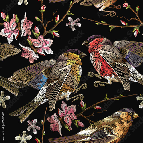 Embroidery birds and blossoming cherry seamless pattern. Classical embroidery bullfinch and titmouse on branch blossoming sakura. Spring fashion pattern, template for design of clothes, t-shirt design - 177610662