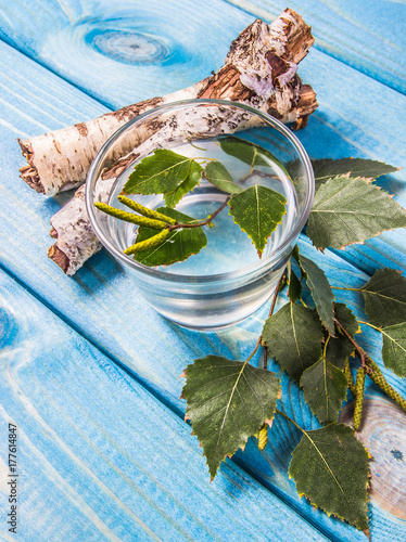Fototapeta A glass of birch juice on wooden background