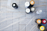 Close-up of cylinders bank with paint stand in a row. The concept of graffiti. View top