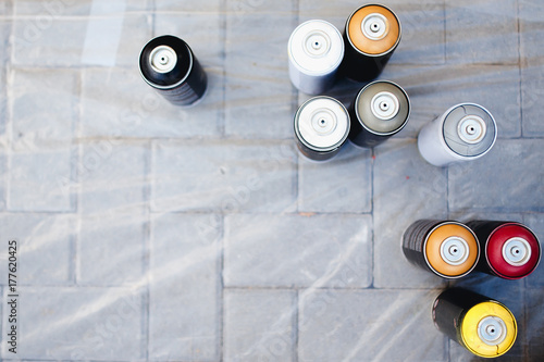Close-up of cylinders bank with paint stand in a row Poster