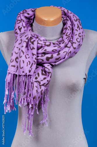 Lilac scarf on mannequin isolated on blue background. Plakat