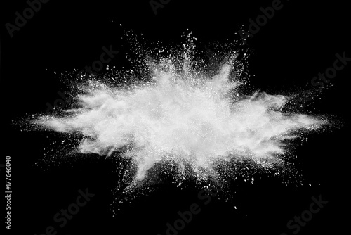 Launched colorful powder, isolated on black background.