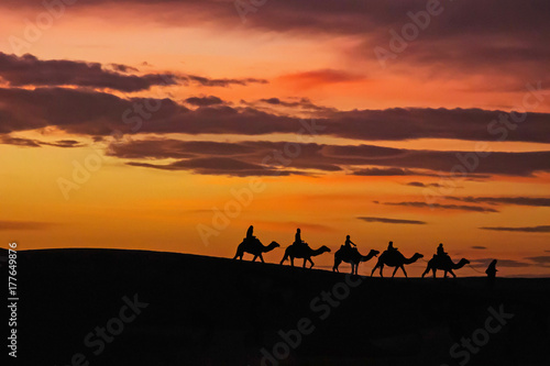 Fotobehang Marokko Morocco Merzouga Erg Chebbi sand dunes caravane sunset
