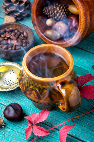 steaming cup of autumn tea Poster