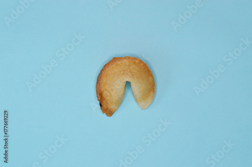 one fortune cookie in blue background Poster