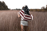 Girl with American Flag in Field - 177670028