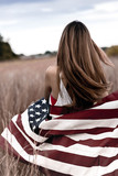 Girl with American Flag in Field - 177670058
