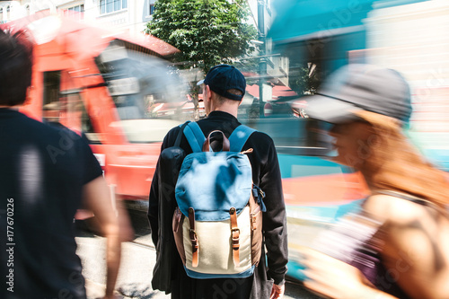 Man standing near driveway and blurred people Poster