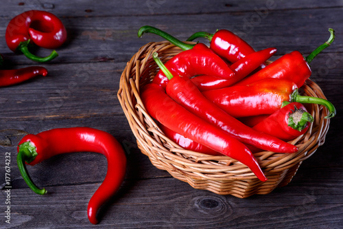 Fotobehang Hot chili peppers Red chili pepper on a kitchen table