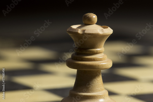 Poster A white queen chess piece