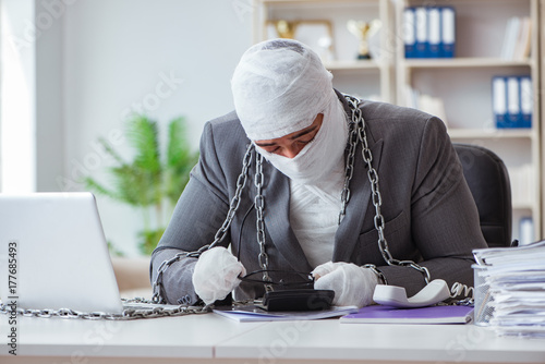 Bandaged businessman worker working in the office doing paperwor Poster