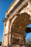 Bottom view on the incredibly decorated arch of Titus in Rome, Italy - 177689274