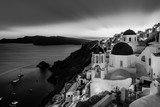 Black and white cityscape of Oia, traditional greek village with blue domes of churches, Santorini island, Greece at dusk. - 177696454