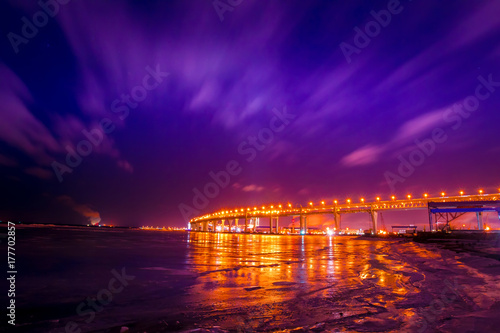 Fotobehang Violet Flying clouds at night. Winter landscape. Industrial landscape.