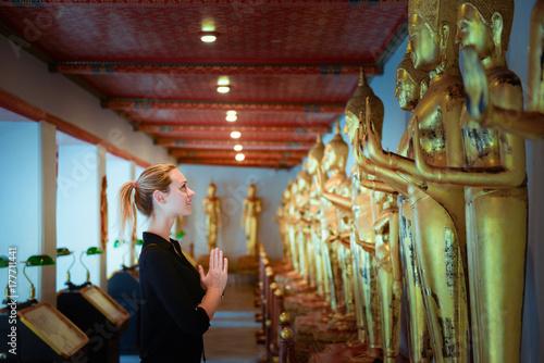 European tourist beautiful woman is visiting at Wat Pho in Bangkok, Thailand Poster