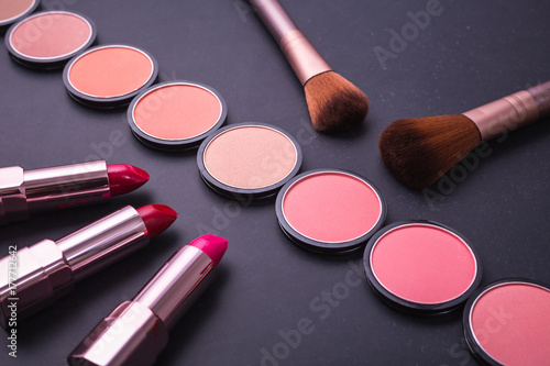 Poster Set of decorative cosmetics and soft brush on stone
