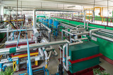 Industrial boiler room. Complex system of pipelines, pumps.