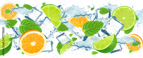 lime and orange splash water and ice isolated - 177718461