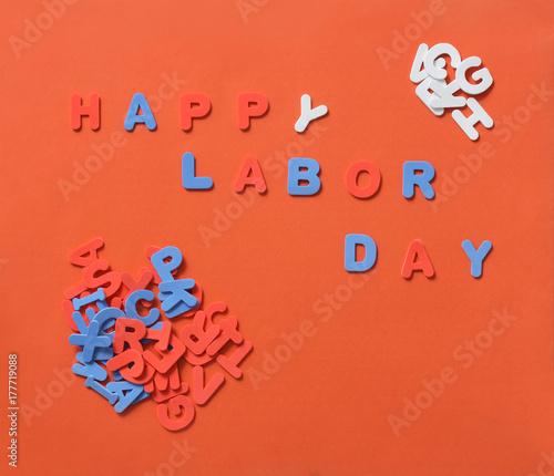 Happy Labor Day text against orange background