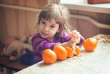 Child and tangerine. Selective focus.