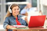 Relaxed student watching media on line in a coffee shop - 177724446