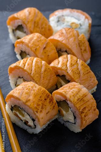 Papiers peints Sushi bar Fresh and tasty traditional Japanese sushi rolls close up.