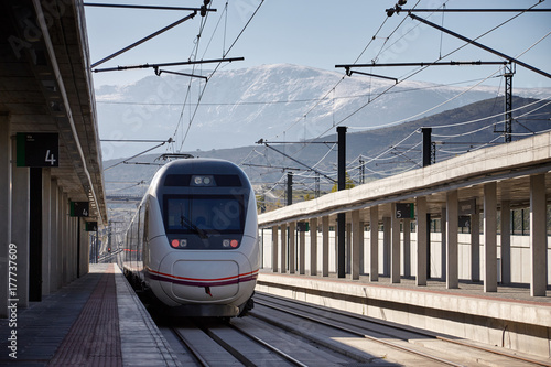 Fast train on a station in Segovia Spain. Mountains on background.