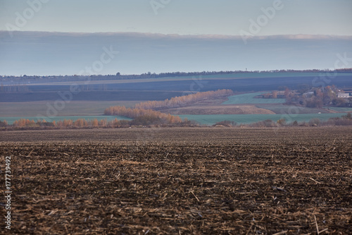 Fotobehang Chocoladebruin arable land in the autumn. black earth