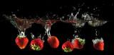 Strawberries splashing into water - 177752686