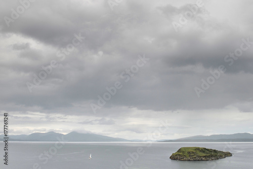 Clouds and Sailing boat and island in Scotland - 177769241