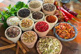 Variety of different asian and middle east spices, colorful assortment, on old wooden table - 177778044
