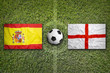 Spain vs. England flags on soccer field