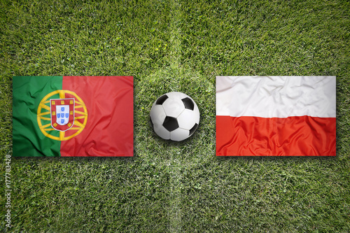 Portugal vs. Poland flags on soccer field Poster